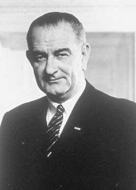 President Lyndon B. Johnson standing in the White House Office.