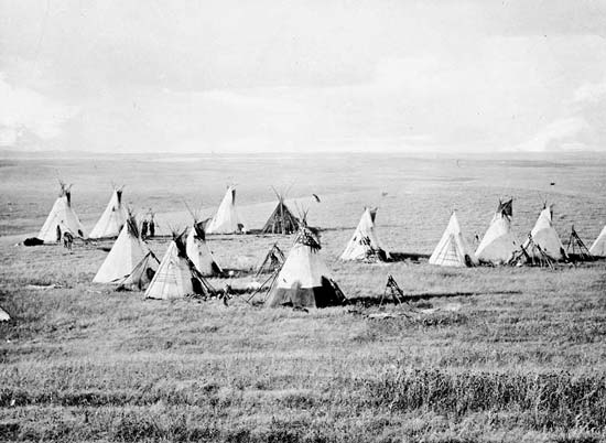 A group of Cree camp on the Canadian plain.
