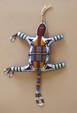 Native Americans from all regions are known for their beadwork. They use beads on clothing, bags, and other objects. A Cheyenne amulet, or charm, is an example of such beadwork.