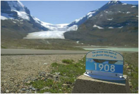 A marker shows the location of one of the glaciers in Canada's Jasper National Park as of 1908, illustrating how much the glacier has melted and receded since that time.