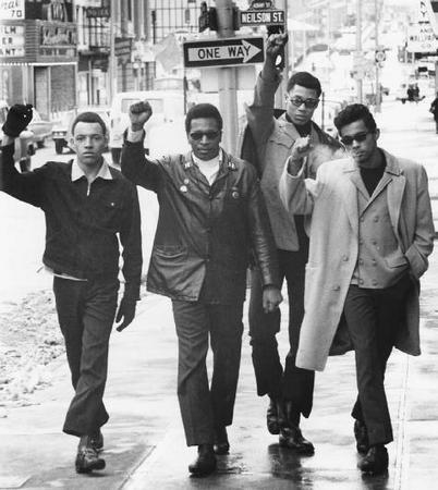 Black Panthers (left to right) 2nd Lieutenant James Pelser, Captain Jerry James, First Lieutenant Greg Criner, and First Lieutenant Robert Reynolds in New Brunswick, New Jersey, in 1969. AP/WIDE WORLD PHOTOS