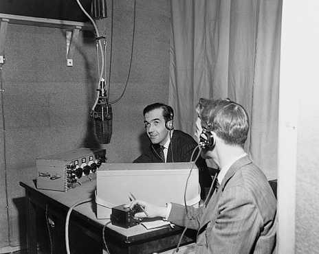 Edward R. Murrow broadcasting news of the Allied invasion of France. Besides him is the military censor, his hand on the switch that would interrupt the transmission if he felt necessary.  Corbis-Bettmann.