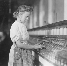A girl at work on a power loom in a Cherryville, North Carolina, textile mill, 1908. THE LIBRARY OF CONGRESS.