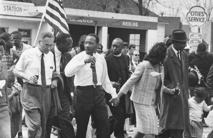 Civil Rights March from Selma, AL, to the State Capital in Montgomery, March 1965. Martin Luther King Jr. and his wife, Coretta Scott King, lead a voting rights march that becomes the political and emotional peak of the civil rights movement. L
