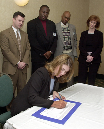 Jennifer Gratz, January 2004. Gratz (seated) was the successful lead plaintiff in the U.S. Supreme Courts 2003 decision in Gratz v. Bollinger, which declared the University of Michigans admission policy