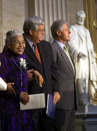 Rosa Parks, Capitol Hill, Washington, DC, 1999. Parks, standing alongside Speaker of the House Dennis Hastert and President Bill Clinton, is honored for her achievements in civil rights with the Congressional Gold Medal, the highest civilian ho