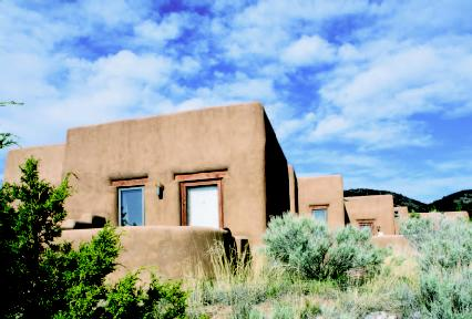 Adobe house with passive solar power.