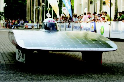 The solar car from The University of Calgary, Canada, leaves the starting point in Darwin on Sunday, September 25, 2005, in the 8th World Solar Challenge. Twenty-two solar-powered cars from the United States, France, Japan, and Canada will be t