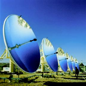 Tracking parabolic solar dishes concentrate incoming solar radiation to a central point, where a thermal collector captures the heat and transforms it into energy.