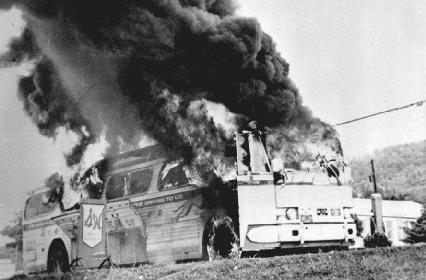 A Freedom Rider bus burns after someone from an angry mob of segregationists tossed a firebomb through one of its windows. Members of that mob beat the civil rights activists who were onboard as they evacuated the bus through an emergency exit.