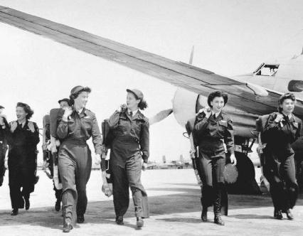 Members of the Women Airforce Service Pilots (WASP) are shown working on the flight line at New Castle Army Air Base in Delaware. Working with the 2nd Ferrying Group, they transported planes, towed targets, and acted as pilots during training e