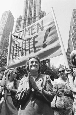 Betty Friedan (center) walks in a womens rights parade in New York City. Her groundbreaking book, The Feminine Mystique, helped fuel the womens liberation movement.