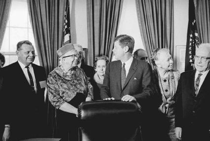 On December 14, 1961, President John F. Kennedy (center) established the Presidents Commission on the Status of Women, with former First Lady Eleanor Roosevelt (second from left) as its head.