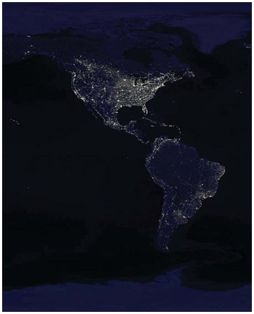 Satellite photograph of the US at night, emphasizing the clustering of human settlements.