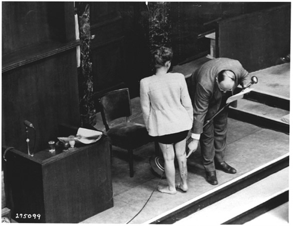 Polish concentration camp survivor Jadwiga Dzido and Dr. Leo Alexander show the scar on her right leg during the Doctors Trial portion of the Nuremberg Trials of the Nazis in Nuremberg, Germany, December 22, 1946.
