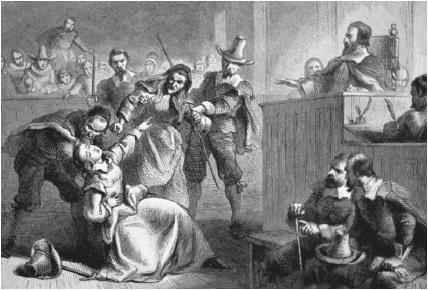 A man helps an alleged witchcraft victim during the infamous Salem witch trials in Massachusetts.