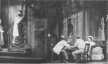 Marlon Brando as Stanley (on stairs at left) in a Broadway production