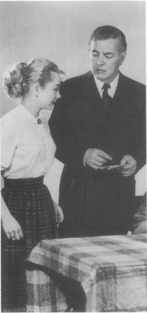 Marie (Joan Lorring) greets Doc (Sidney Blackmer) at the breakfast table in the original Broadway production