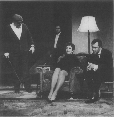 Ruth (Jane Lowe) is surrounded by her husbands family, (left to right) Max (John Savident), Joey (Terence Rigby), and Lenny (playwright Pinter taking a turn at acting)