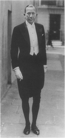 Noel Coward as he prepares to leave his home for a royal function at St. Jamess Palace, London, 1937