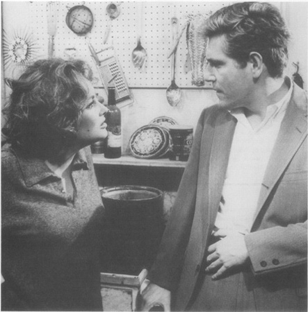 Martha (Elizabeth Taylor) berates Nick (George Segal) in a scene from the 1966 film adaptation. Taylors performance won her an Academy Award for best actress