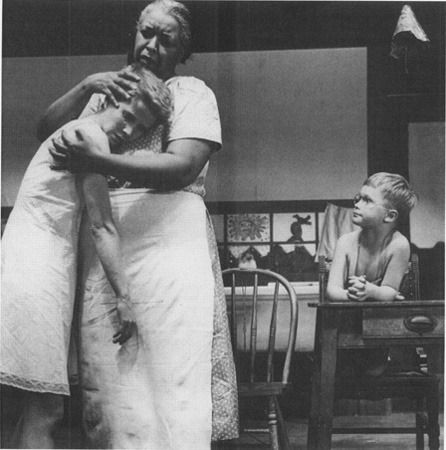Despite the racial barrier that exists between them, Frankie (Julie Harris) is still able to take comfort from Berenice (Ethel Waters) as John Henry (Brandon de Wilde) looks on