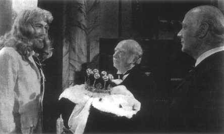 The mad Jack Gurney (Peter OToole) is offered his crown by his butler, Tucker, in the film version of Barness play