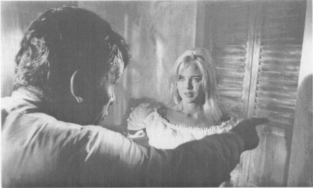 A scene from the film: Shannon (Burton) orders Charlotte (Sue Lyons) out of his room