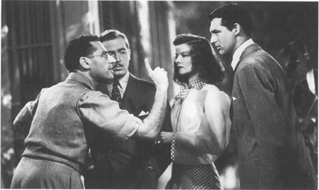 George Cukor directing The Philadelphia Story, with John Howard as George Kittredge, Katharine Hepburn as Tracy Lord, and Cary Grant as C. K. Dexter Haven.