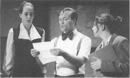 A scene from the 1996 University of Kansas Theatre production of The, Memorandum, featuring (from left to right) Jennette Selig as Jan Ballas, Jefferson R. Bachura as Otto Stroll, and Jamie Johnson as Helena.