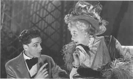 Margaret Rutherford, as Madame Desmermortes, talking to Paul Schofield, as Hugo, in a 1950 production of Ring around the Moon.