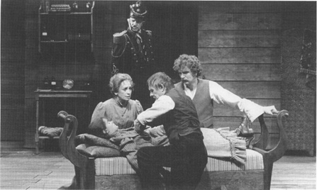 In a scene from a 1979 production of The Wild Duck at Londons Olivier Theatre, Old Ekdal (in uniform) looks on while Dr. Relling, Gina Ekdal, and Hjalmar Ekdal attend to Hedvig Ekdal
