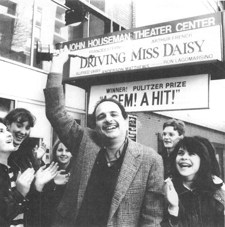 Alfred Uhry standing beneath a marquee promoting his Pulitzer Prize-winning play, Driving Miss Daisy.