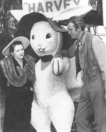Playwright Mary Coyle Chase and actor James Stewart pose with the giant rabbit featured in the 1950 film adaptation of Harvey.