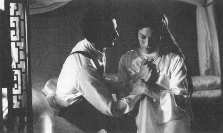 A scene from the 1993 film adaptation of M. Butterfly, starring Jeremy Irons (left) and John Lone