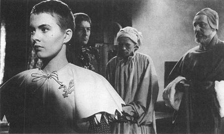 Jean Seberg (left) as Joan of Arc in the 1957 film adaptation of Saint Joan.