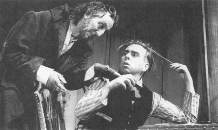 Bob Goody as Ossip and Timothy Spall as Hlestakov in a scene from a theatrical production of The Government Inspector.