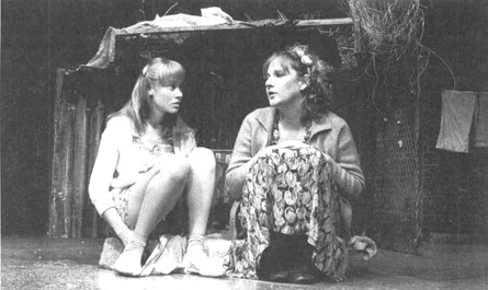 Beth Goddard as Kit and Lesley Sharp as Angie in a scene from a theatrical production of Top Girls.
