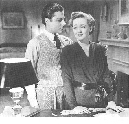 Bette Davis, as Sara Mller, and Paul Lukas, as Kurt Mller, in a scene from the 1943 film production of Watch on the Rhine