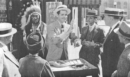 A scene from the 1939 film adaptation of Idiots Delight, featuring Clark Gable, as Henry Van