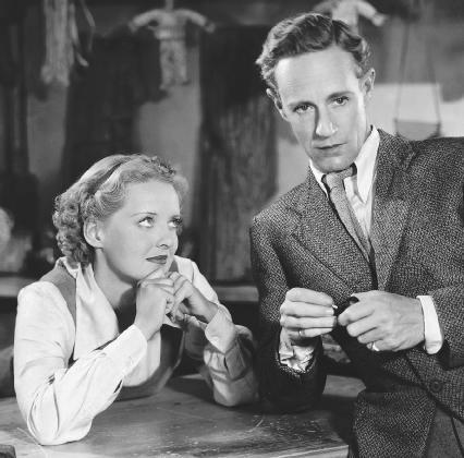 A scene from the 1936 film adaptation of The Petrified Forest, featuring Bette Davis and Leslie Howard