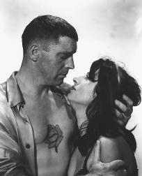 Burt Lancaster, as Alvaro Mangiacavallo, and Anna Magnani, as Serafina Delle Rose, in a scene from the 1955 film adaptation of The Rose Tattoo, directed by Daniel Mann