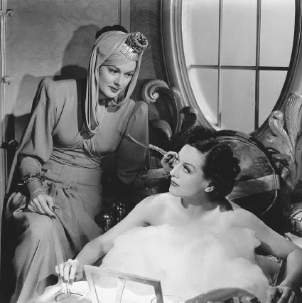 Rosalind Russell and Joan Crawford in the 1939 film The Women, written by Clare Boothe Luce