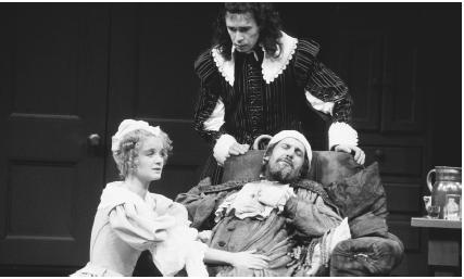 Emily Morgan, Clive Arrindell, and Daniel Massey in a scene from the 1981 stage production of The Hypochondriac, a translated version of the The Imaginary Invalid, performed at the Olivier Theatre in London.