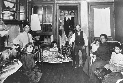 Jacob Riis photographed this poor family in their tenement apartment.