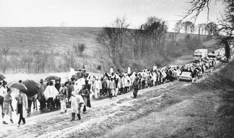 Civil rights marchers, 1965. Walking fifty-four miles along Route 80 from Selma to the state capitol in Montgomery, Alabama, where they will demonstrate for African-American voting rights, the activists endure rain on the third day of their jou
