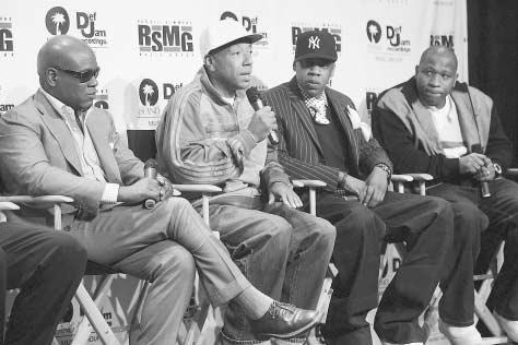 Producer Russell Simmons, holding a microphone, is joined by (from left) Antonio L.A. Reid, Jay Z, and Tony Austin, New York City, 2005. Simmons, whose efforts and vision as rap producer and artists manager helped propel rap music onto the nati