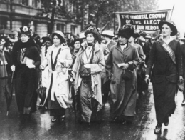 Emmeline Pankhurst (center) leading a protest march, July 1915. Pankhurst and other feminists voice...