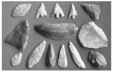These prehistoric flint tools were used for hunting and preparing food. © MAURICE NIMMO; FRANK LANE PICTURE AGENCY/CORBIS.