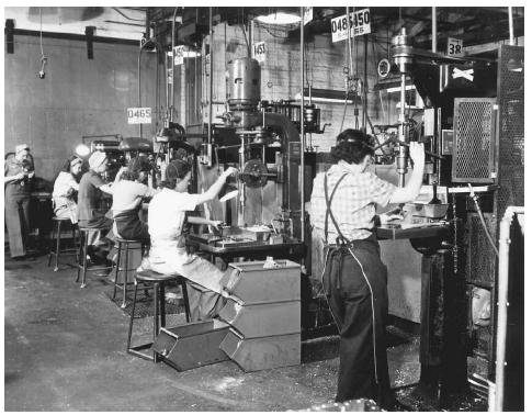 During the early 1940s thousands of American women began working in factories in support of the war effort. The swing shift of drill press operators at this West Coast airplane factory was composed entirely of women when this photograph was taken in 1942.  FRANKLIN DELANO ROOSEVELT LIBRARY